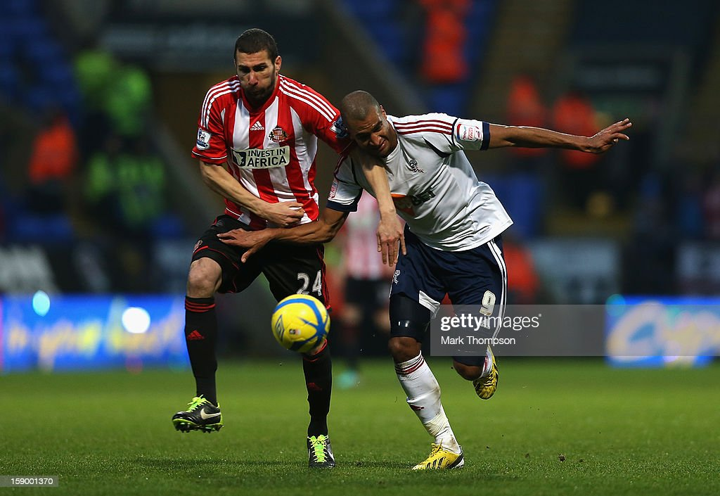 Carlos Cuellar of Sunderland battles fo rthe ball with <a gi-track='captionPersonalityLinkClicked' href=/galleries/search?phrase=David+N%27Gog&family=editorial&specificpeople=4174232 ng-click='$event.stopPropagation()'>David N'Gog</a> of Bolton Wanderers during the FA Cup with Budweiser Third Round match between Bolton Wanderers and Sunderland at the Reebok Stadium on January 5, 2013 in Bolton, England.