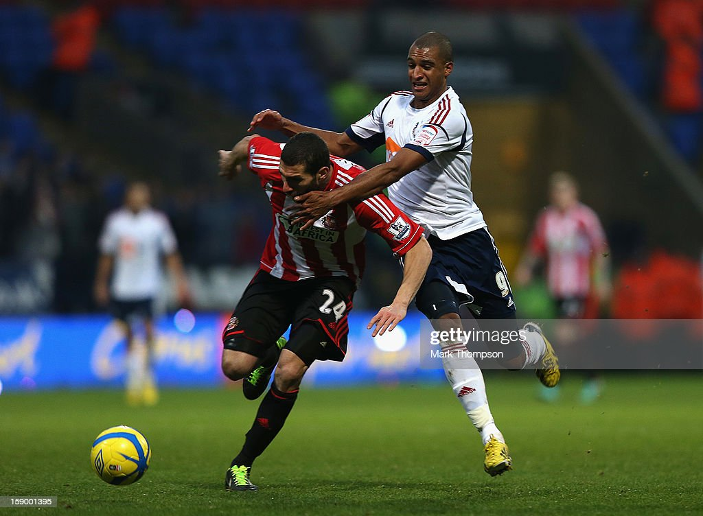<a gi-track='captionPersonalityLinkClicked' href=/galleries/search?phrase=Carlos+Cuellar&family=editorial&specificpeople=2116627 ng-click='$event.stopPropagation()'>Carlos Cuellar</a> of Sunderland battles for the ball with <a gi-track='captionPersonalityLinkClicked' href=/galleries/search?phrase=David+N%27Gog&family=editorial&specificpeople=4174232 ng-click='$event.stopPropagation()'>David N'Gog</a> of Bolton Wanderers during the FA Cup with Budweiser Third Round match between Bolton Wanderers and Sunderland at the Reebok Stadium on January 5, 2013 in Bolton, England.