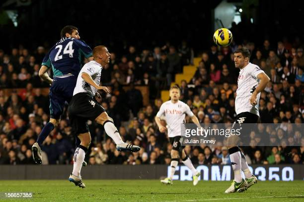 Carlos Cuellar of Sunderland rises above Steve Sidwell of Fulham to score his team's second goal during the Barclays Premier League match between...