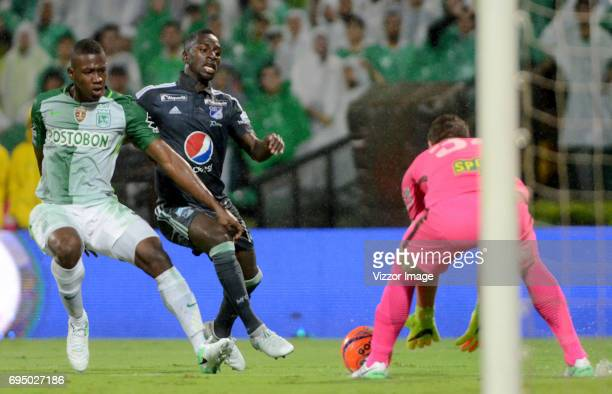 Carlos Cuesta of Atletico Nacional fights for the ball with Deiver Machado of Millonarios during the semi finals second leg match between Atletico...