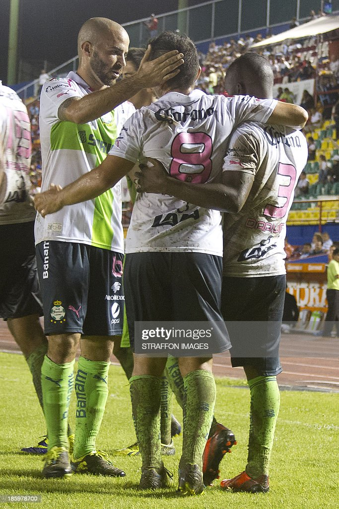 Carlos Darwin Quintero celebrates his goal with Juan Pablo Rodriguez and <a gi-track='captionPersonalityLinkClicked' href=/galleries/search?phrase=Marc+Crosas&family=editorial&specificpeople=4084586 ng-click='$event.stopPropagation()'>Marc Crosas</a> during a match between Atlante and Santos Laguna as part of the Apertura 2013 Liga MX at Olympic Stadium Andres Quintana Roo on October 26, 2013 in Cancun, Mexico.