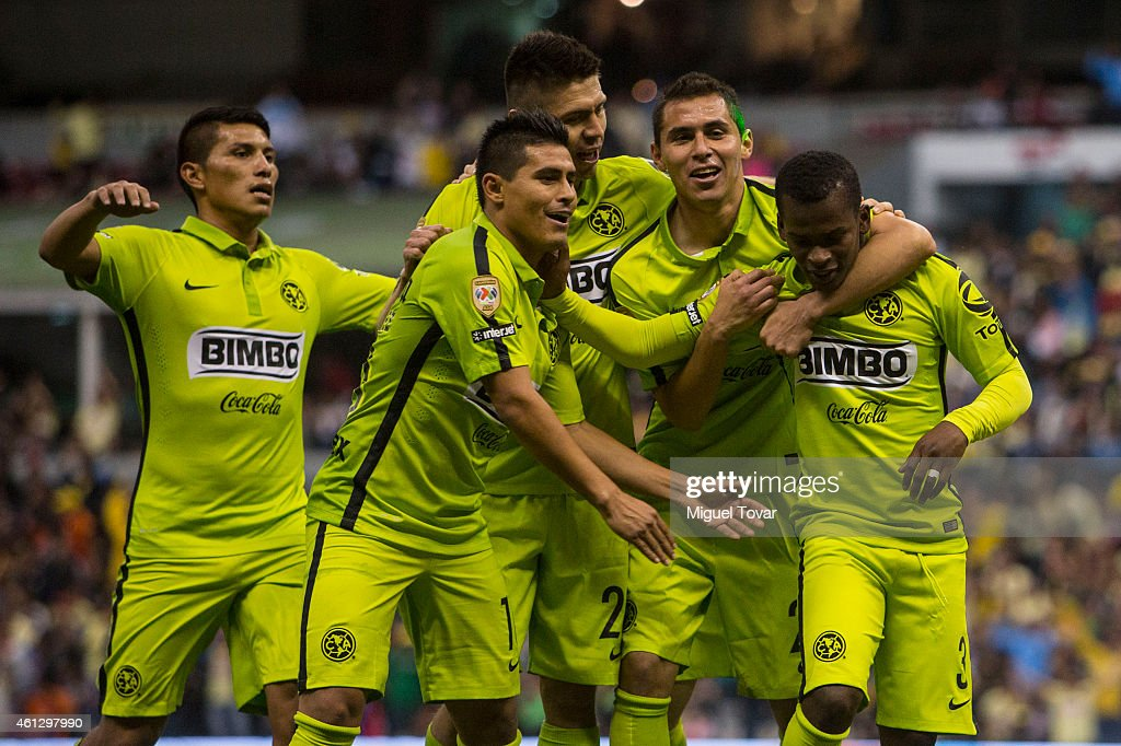 Carlos Darwin Quintero of America celebrates with teammates after scoring the third goal of his team during a match between America and Leon as part...
