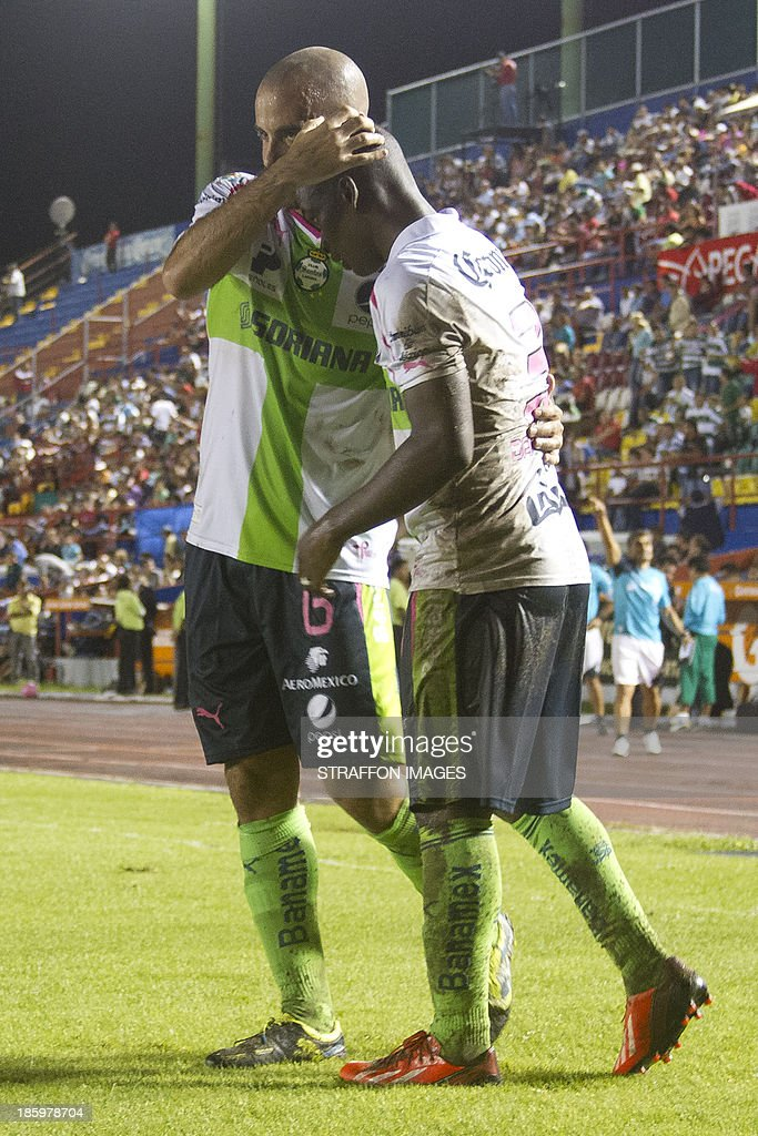 Carlos Darwin Quintero of Santos celebrates his goal with <a gi-track='captionPersonalityLinkClicked' href=/galleries/search?phrase=Marc+Crosas&family=editorial&specificpeople=4084586 ng-click='$event.stopPropagation()'>Marc Crosas</a> during a match between Atlante and Santos Laguna as part of the Apertura 2013 Liga MX at Olympic Stadium Andres Quintana Roo on October 26, 2013 in Cancun, Mexico.