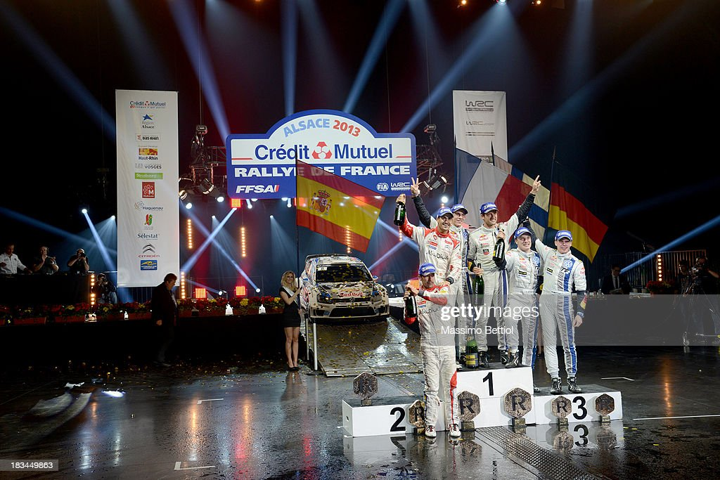 Carlos Del Barrio of Spain and Daniel Sordo of Spain, Julien Ingrassia of France and Sebastien Ogier of France, Mikka Anttila of Finland and Jari Matti Latvala of Finland celebrate on the final podium during Day Three of the WRC France on October 6, 2013 in Strasbourg, France.