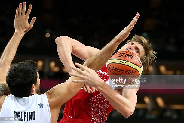 Carlos Delfino of Argentina defends Andrey Kirilenko of Russia during the Men's Basketball bronze medal game between Russia and Argentina on Day 16...