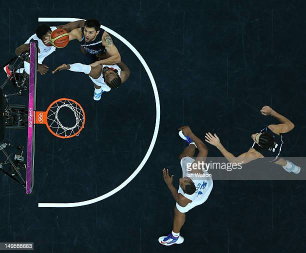 Carlos Delfino of Argentina lays up in the Men's Basketball Preliminary Round match between France and Argentina on Day 4 of the London 2012 Olympic...