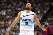 Carlos Delfino of Argentina reacts to a refs out of bounds call during the Men's Basketball bronze medal game between Russia and Argentina on Day 16...