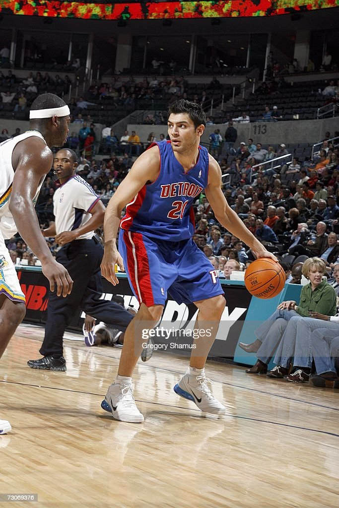 Carlos Delfino #20 of the Detroit Pistons looks to drive the ball against the New Orleans/Oklahoma City Hornets on January 4, 2007 at the Ford Center in Oklahoma City, Oklahoma.