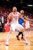 Carlos Delfino of the Houston Rockets and Derek Fisher of the Oklahoma City Thunder battle for rebound position in Game Four of the Western...