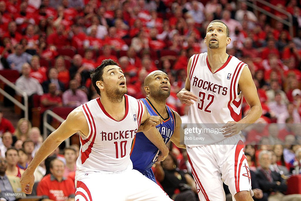 Carlos Delfino #10 of the Houston Rockets and Francisco Garcia #32 of the Houston Rockets sandwich Derek Fisher #6 of the Oklahoma City Thunder on a free throw attempt during Game Four of the Western Conference Quarterfinals of the 2013 NBA Playoffs at the Toyota Center on April 29, 2013 in Houston, Texas.