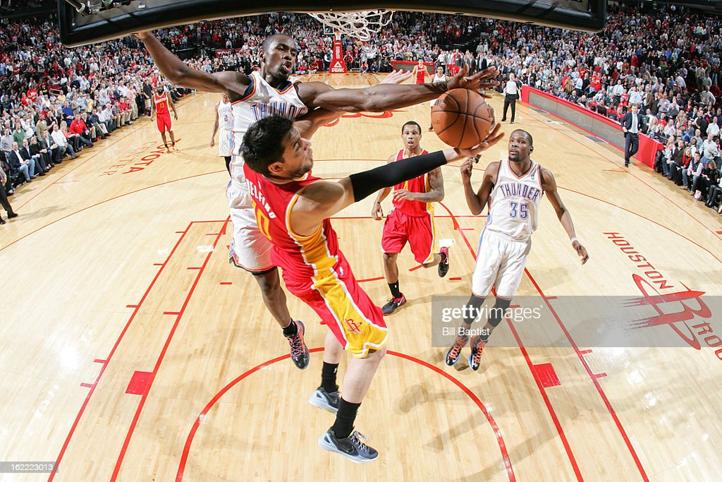 Carlos Delfino #10 of the Houston Rockets attempts a reverse layup against Serge Ibaka #9 of the Oklahoma City Thunder on February 20, 2013 at the Toyota Center in Houston, Texas.