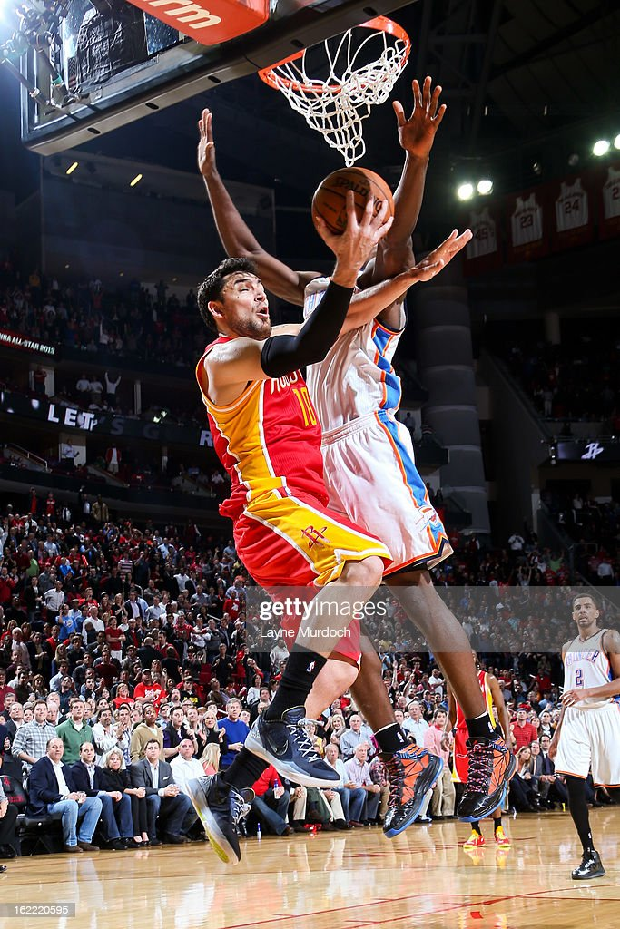 Carlos Delfino #10 of the Houston Rockets attempts a reverse layup against the Oklahoma City Thunder on February 20, 2013 at the Toyota Center in Houston, Texas.