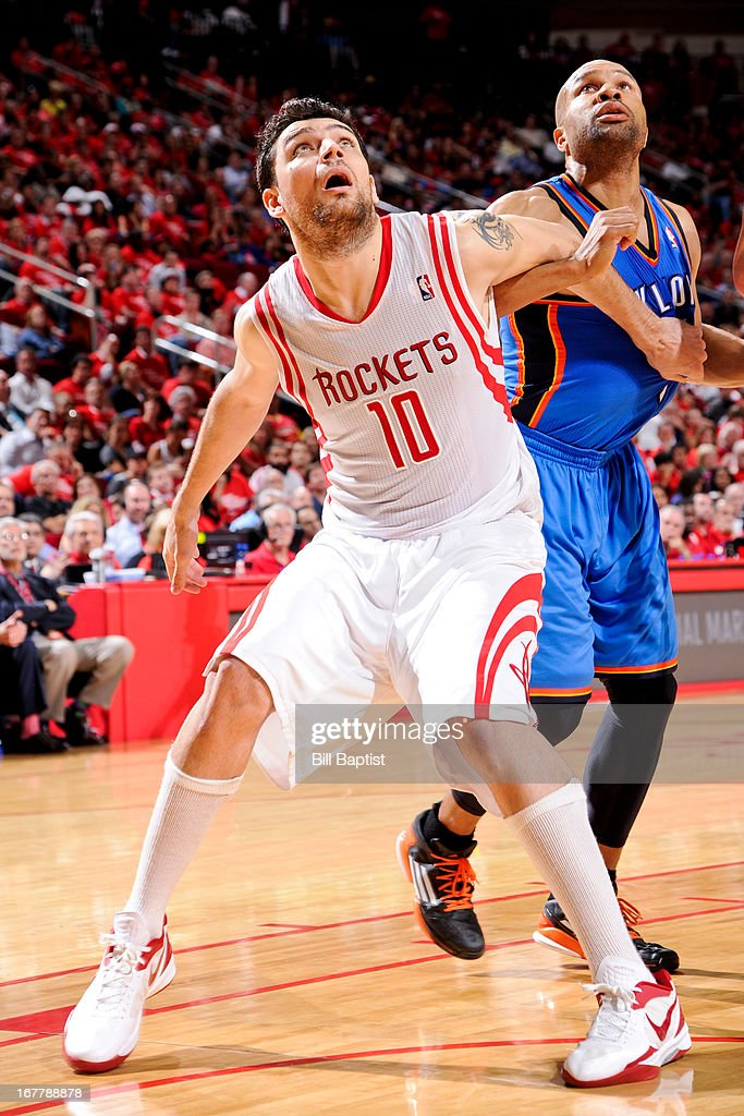 Carlos Delfino #10 of the Houston Rockets battles for rebound position against Derek Fisher #6 of the Oklahoma City Thunder in Game Four of the Western Conference Quarterfinals during the 2013 NBA Playoffs on April 29, 2013 at the Toyota Center in Houston, Texas.