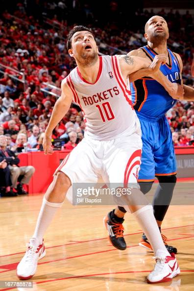Carlos Delfino of the Houston Rockets battles for rebound position against Derek Fisher of the Oklahoma City Thunder in Game Four of the Western...