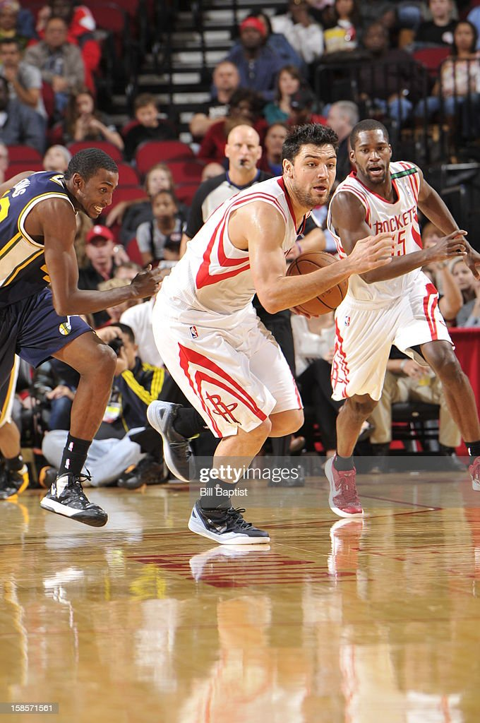 <a gi-track='captionPersonalityLinkClicked' href=/galleries/search?phrase=Carlos+Delfino&family=editorial&specificpeople=206625 ng-click='$event.stopPropagation()'>Carlos Delfino</a> #10 of the Houston Rockets brings the ball up court against the Utah Jazz on December 1, 2012 at the Toyota Center in Houston, Texas.