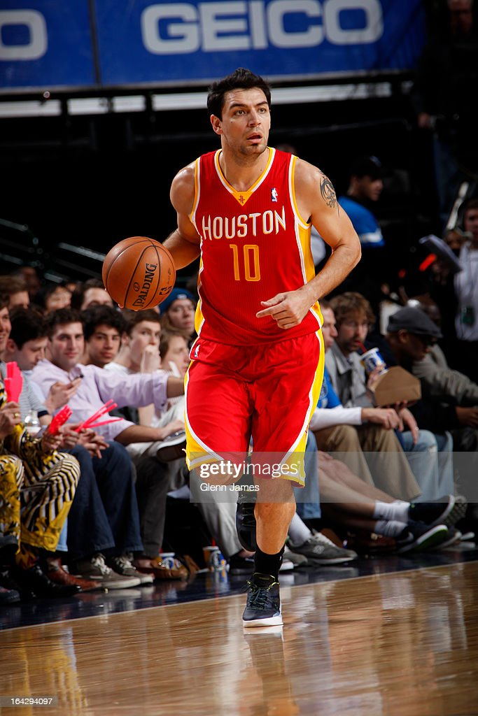 <a gi-track='captionPersonalityLinkClicked' href=/galleries/search?phrase=Carlos+Delfino&family=editorial&specificpeople=206625 ng-click='$event.stopPropagation()'>Carlos Delfino</a> #10 of the Houston Rockets brings the ball up court against the Dallas Mavericks on March 6, 2013 at the American Airlines Center in Dallas, Texas.