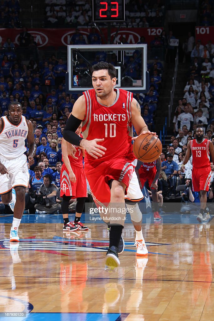 <a gi-track='captionPersonalityLinkClicked' href=/galleries/search?phrase=Carlos+Delfino&family=editorial&specificpeople=206625 ng-click='$event.stopPropagation()'>Carlos Delfino</a> #10 of the Houston Rockets brings the ball up court against the Oklahoma City Thunder in Game Two of the Western Conference Quarter Finals during the 2013 NBA playoffs on April 24, 2013 at the Chesapeake Energy Arena in Oklahoma City, Oklahoma.