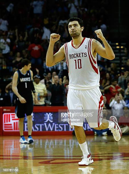 Carlos Delfino of the Houston Rockets celebrates a basket during the game against the Minnesota Timberwolves at Toyota Center on March 15 2013 in...