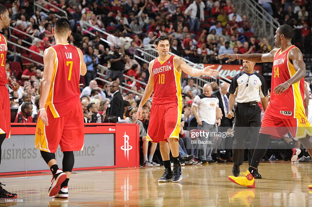 <a gi-track='captionPersonalityLinkClicked' href=/galleries/search?phrase=Carlos+Delfino&family=editorial&specificpeople=206625 ng-click='$event.stopPropagation()'>Carlos Delfino</a> #10 of the Houston Rockets congratulates teammates during a time out in the game against the Atlanta Hawks on December 31, 2012 at the Toyota Center in Houston, Texas.