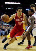 Carlos Delfino of the Houston Rockets drives past Lou Williams of the Atlanta Hawks at the Toyota Center on December 31 2012 in Houston Texas NOTE TO...
