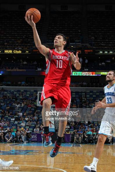 Carlos Delfino of the Houston Rockets drives to the basket against the New Orleans Hornets on October 24 2012 at the New Orleans Arena in New Orleans...
