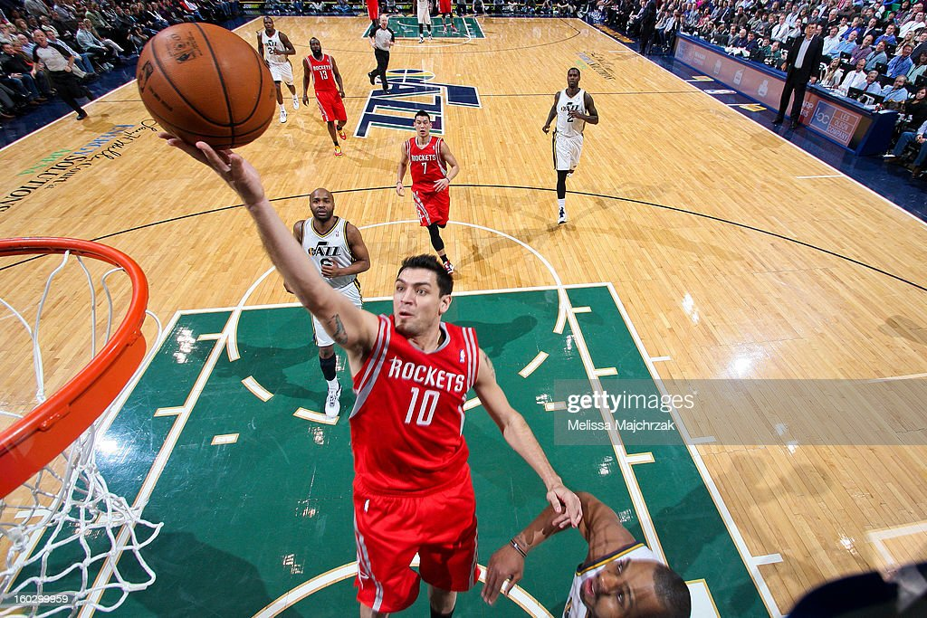 Carlos Delfino #10 of the Houston Rockets drives to the basket against Randy Foye #8 of the Utah Jazz at Energy Solutions Arena on January 28, 2013 in Salt Lake City, Utah.