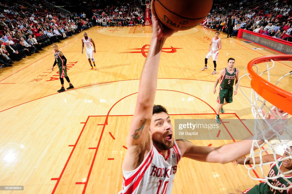 <a gi-track='captionPersonalityLinkClicked' href=/galleries/search?phrase=Carlos+Delfino&family=editorial&specificpeople=206625 ng-click='$event.stopPropagation()'>Carlos Delfino</a> #10 of the Houston Rockets dunks against the Milwaukee Bucks on February 27, 2013 at the Toyota Center in Houston, Texas.