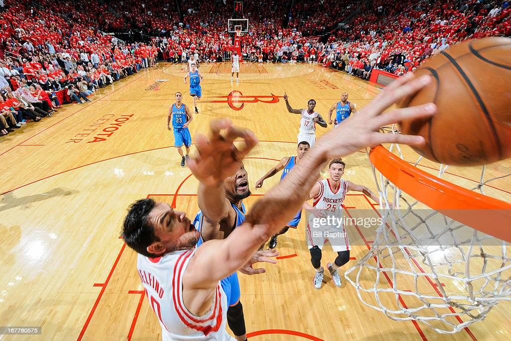 Carlos Delfino #10 of the Houston Rockets dunks the ball against Kevin Durant #35 of the Oklahoma City Thunder in Game Four of the Western Conference Quarterfinals during the 2013 NBA Playoffs on April 29, 2013 at the Toyota Center in Houston, Texas.