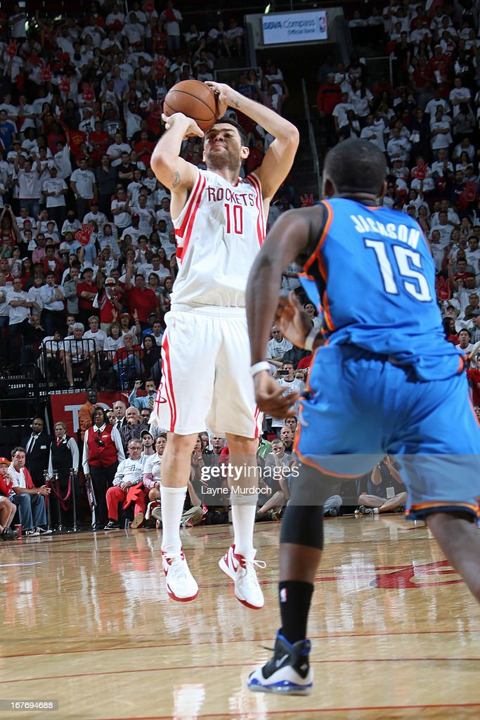 Carlos Delfino #10 of the Houston Rockets goes for a jump shot against Reggie Jackson #15 of the Oklahoma City Thunder during the Game Three of the Western Conference Quarterfinals between the Houston Rockets and the Oklahoma City Thunder during the 2013 NBA Playoffs on April 27, 2013 at the Toyota Center in Houston, Texas.