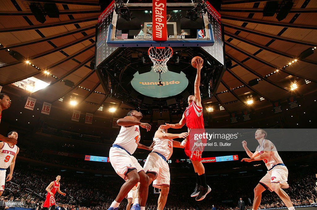 Carlos Delfino #10 of the Houston Rockets goes up for a layup against Jason Kidd #5 of the New York Knicks on December 17, 2012 at Madison Square Garden in New York City.
