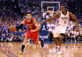 Carlos Delfino of the Houston Rockets handles the ball guarded by Serge Ibaka of the Oklahoma City Thunder during the second half of Game Two of the...