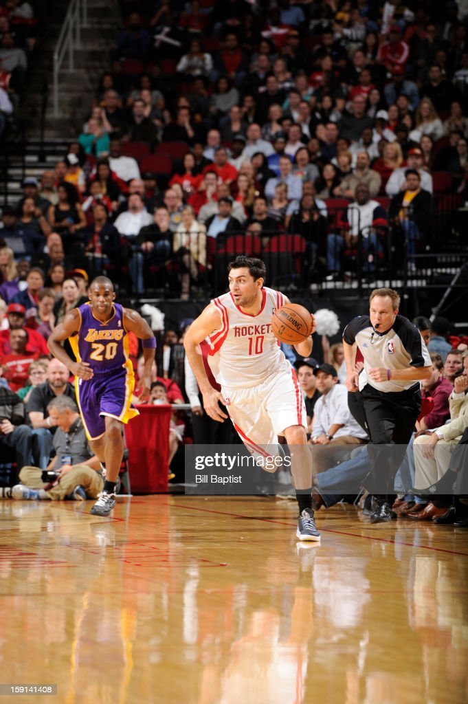 Carlos Delfino #10 of the Houston Rockets handles the ball up-court against Jodie Meeks #20 of the Los Angeles Lakers on January 8, 2013 at the Toyota Center in Houston, Texas.