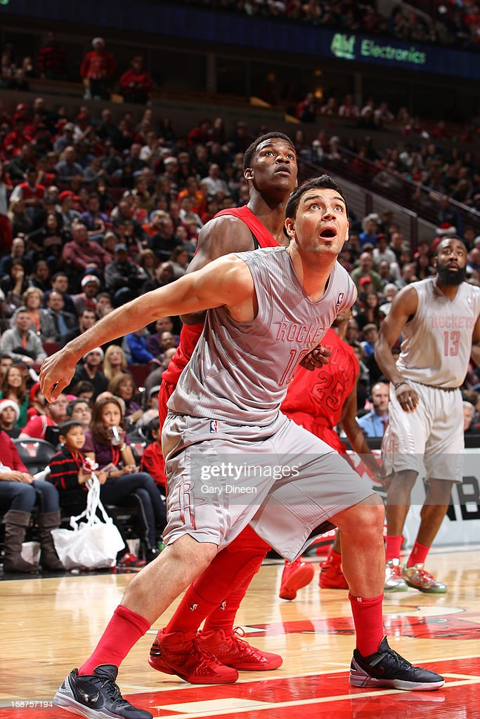 <a gi-track='captionPersonalityLinkClicked' href=/galleries/search?phrase=Carlos+Delfino&family=editorial&specificpeople=206625 ng-click='$event.stopPropagation()'>Carlos Delfino</a> #10 of the Houston Rockets looks to rebound the ball against the Chicago Bulls during a Christmas Day game on December 25, 2012 at the United Center in Chicago, Illinois.