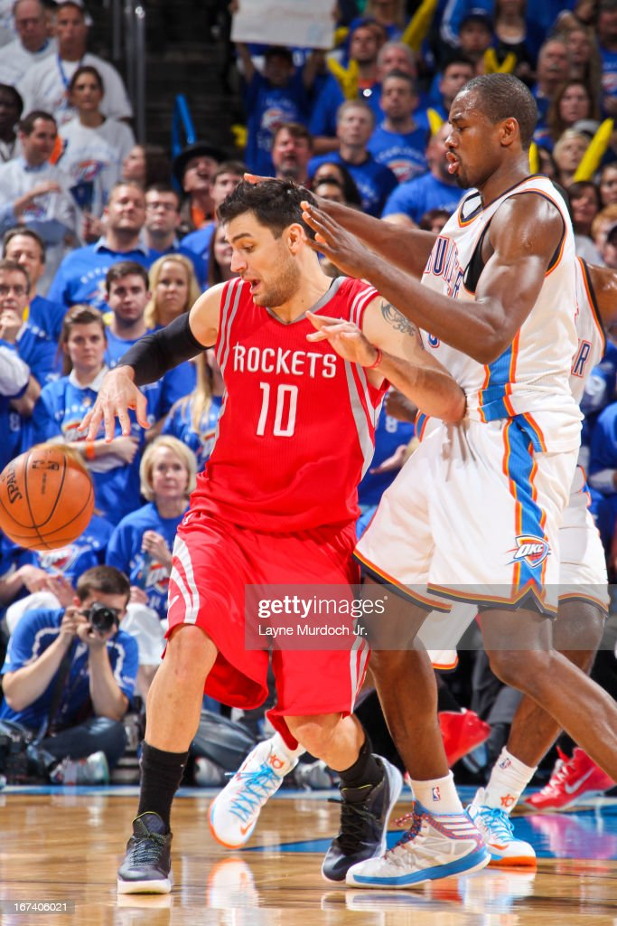 Carlos Delfino #10 of the Houston Rockets loses control of the ball against Serge Ibaka #9 of the Oklahoma City Thunder in Game Two of the Western Conference Quarterfinals during the 2013 NBA Playoffs on April 24, 2013 at the Chesapeake Energy Arena in Oklahoma City, Oklahoma.