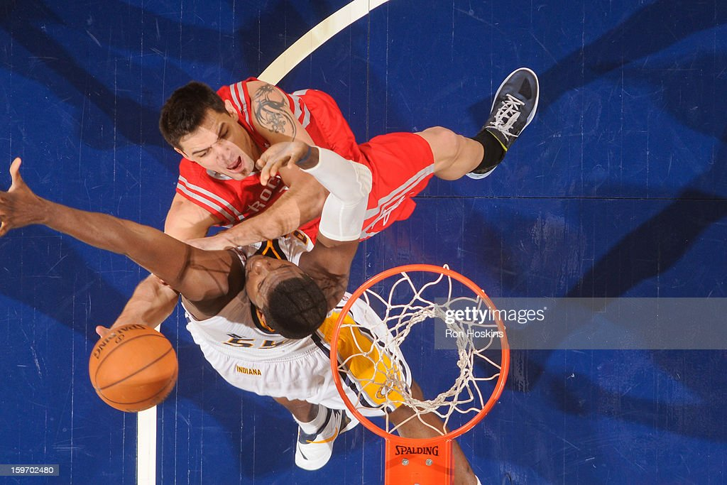 <a gi-track='captionPersonalityLinkClicked' href=/galleries/search?phrase=Carlos+Delfino&family=editorial&specificpeople=206625 ng-click='$event.stopPropagation()'>Carlos Delfino</a> #10 of the Houston Rockets shoots a layup against <a gi-track='captionPersonalityLinkClicked' href=/galleries/search?phrase=Roy+Hibbert&family=editorial&specificpeople=725128 ng-click='$event.stopPropagation()'>Roy Hibbert</a> #55 of the Indiana Pacers on January 18, 2013 at Bankers Life Fieldhouse in Indianapolis, Indiana.
