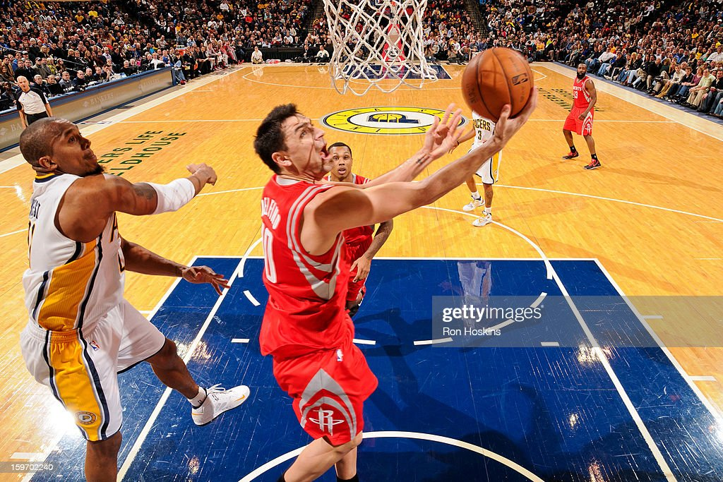 Carlos Delfino #10 of the Houston Rockets shoots a reverse layup against David West #21 of the Indiana Pacers on January 18, 2013 at Bankers Life Fieldhouse in Indianapolis, Indiana.