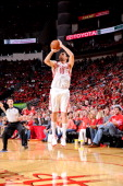 Carlos Delfino of the Houston Rockets shoots a threepointer against the Oklahoma City Thunder in Game Four of the Western Conference Quarterfinals...