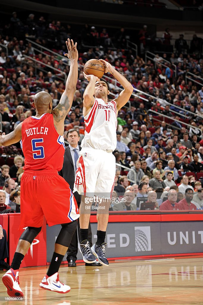 Carlos Delfino #10 of the Houston Rockets shoots against Caron Butler #5 of the Los Angeles Clippers on January 15, 2013 at the Toyota Center in Houston, Texas.
