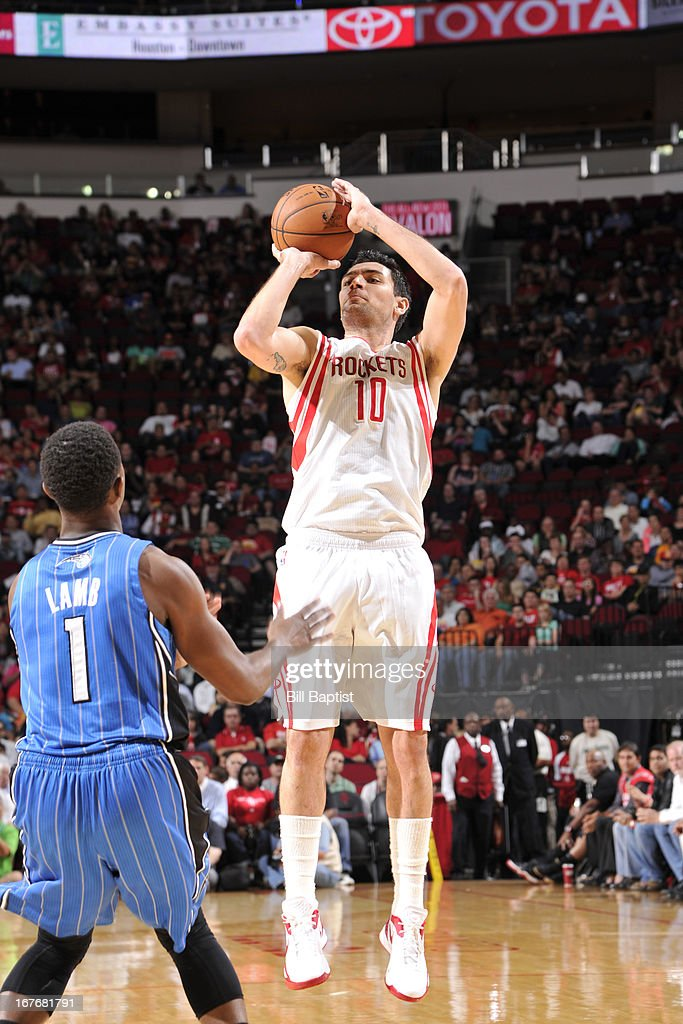 <a gi-track='captionPersonalityLinkClicked' href=/galleries/search?phrase=Carlos+Delfino&family=editorial&specificpeople=206625 ng-click='$event.stopPropagation()'>Carlos Delfino</a> #10 of the Houston Rockets shoots against <a gi-track='captionPersonalityLinkClicked' href=/galleries/search?phrase=Doron+Lamb&family=editorial&specificpeople=7143029 ng-click='$event.stopPropagation()'>Doron Lamb</a> #1 of the Orlando Magic on April 1, 2013 at the Toyota Center in Houston, Texas.