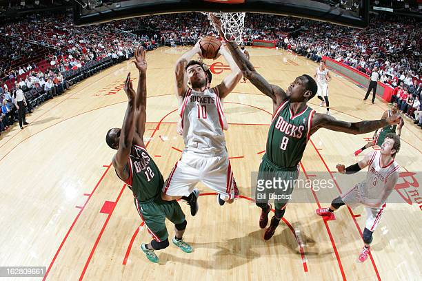 Carlos Delfino of the Houston Rockets shoots against Larry Sanders and Luc Mbah a Moute of the Milwaukee Bucks on February 27 2013 at the Toyota...