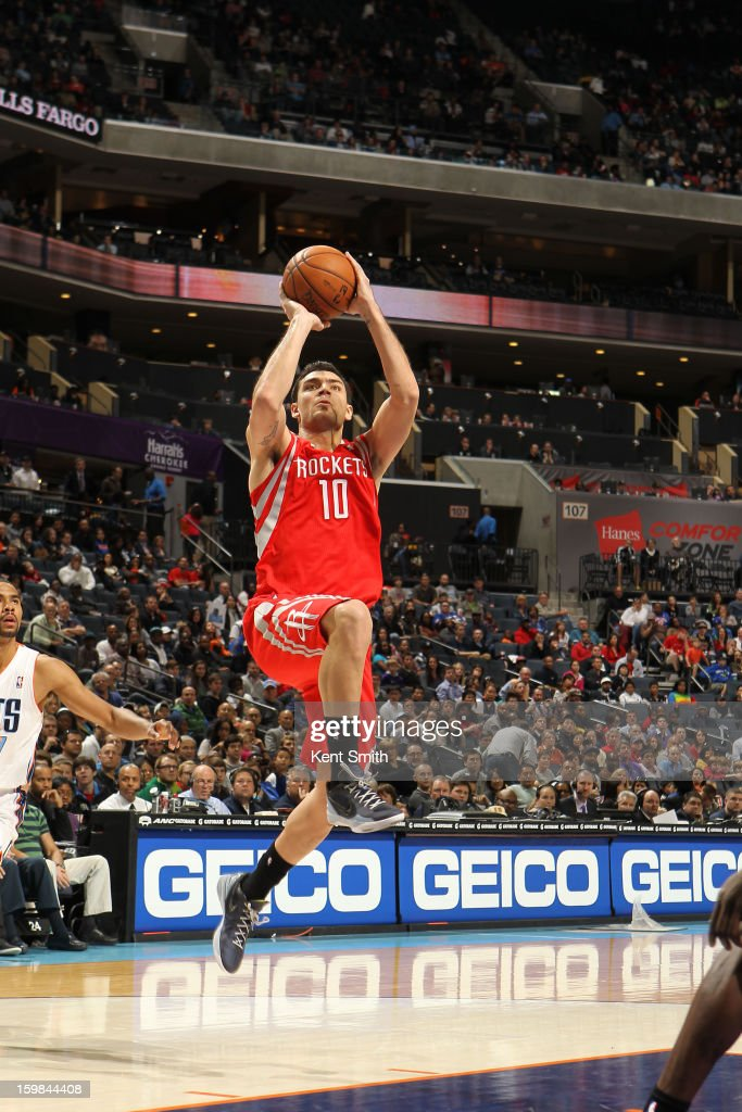 Carlos Delfino #10 of the Houston Rockets shoots against the Charlotte Bobcats at the Time Warner Cable Arena on January 21, 2013 in Charlotte, North Carolina.