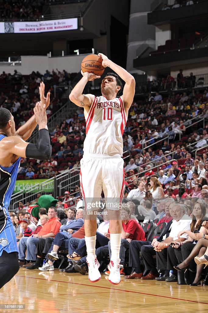 <a gi-track='captionPersonalityLinkClicked' href=/galleries/search?phrase=Carlos+Delfino&family=editorial&specificpeople=206625 ng-click='$event.stopPropagation()'>Carlos Delfino</a> #10 of the Houston Rockets shoots against the Orlando Magic on April 1, 2013 at the Toyota Center in Houston, Texas.