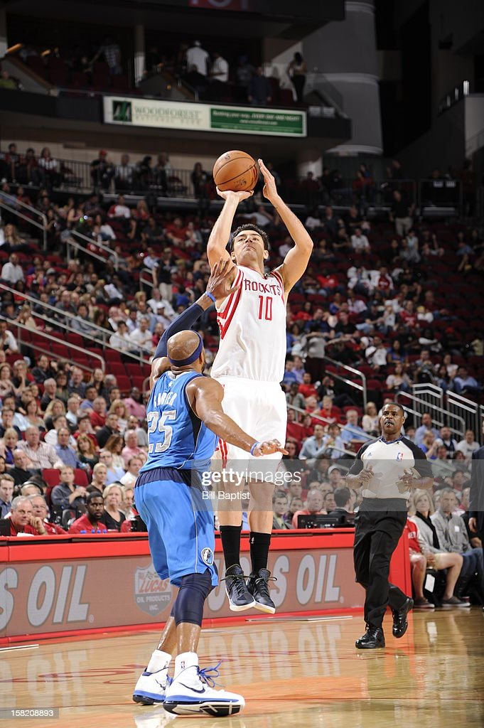 <a gi-track='captionPersonalityLinkClicked' href=/galleries/search?phrase=Carlos+Delfino&family=editorial&specificpeople=206625 ng-click='$event.stopPropagation()'>Carlos Delfino</a> #10 of the Houston Rockets shoots against <a gi-track='captionPersonalityLinkClicked' href=/galleries/search?phrase=Vince+Carter&family=editorial&specificpeople=201488 ng-click='$event.stopPropagation()'>Vince Carter</a> #25 of the Dallas Mavericks on December 8, 2012 at the Toyota Center in Houston, Texas.