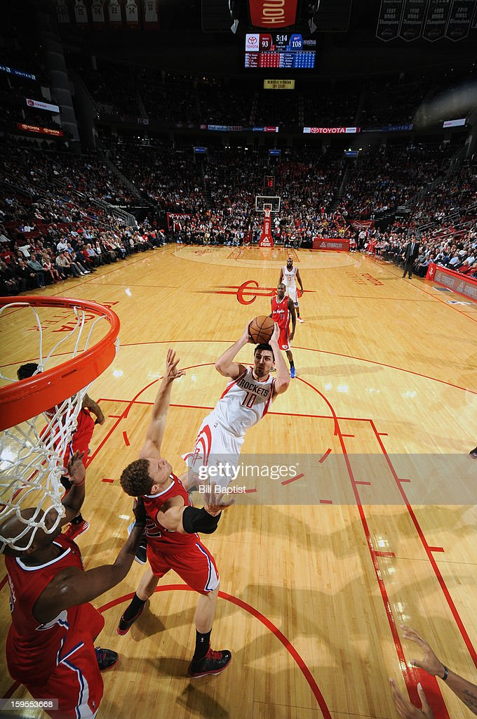 <a gi-track='captionPersonalityLinkClicked' href=/galleries/search?phrase=Carlos+Delfino&family=editorial&specificpeople=206625 ng-click='$event.stopPropagation()'>Carlos Delfino</a> #10 of the Houston Rockets shoots the ball over <a gi-track='captionPersonalityLinkClicked' href=/galleries/search?phrase=Blake+Griffin+-+Giocatore+di+basket&family=editorial&specificpeople=4216010 ng-click='$event.stopPropagation()'>Blake Griffin</a> #32 of the Los Angeles Clippers on January 15, 2013 at the Toyota Center in Houston, Texas.