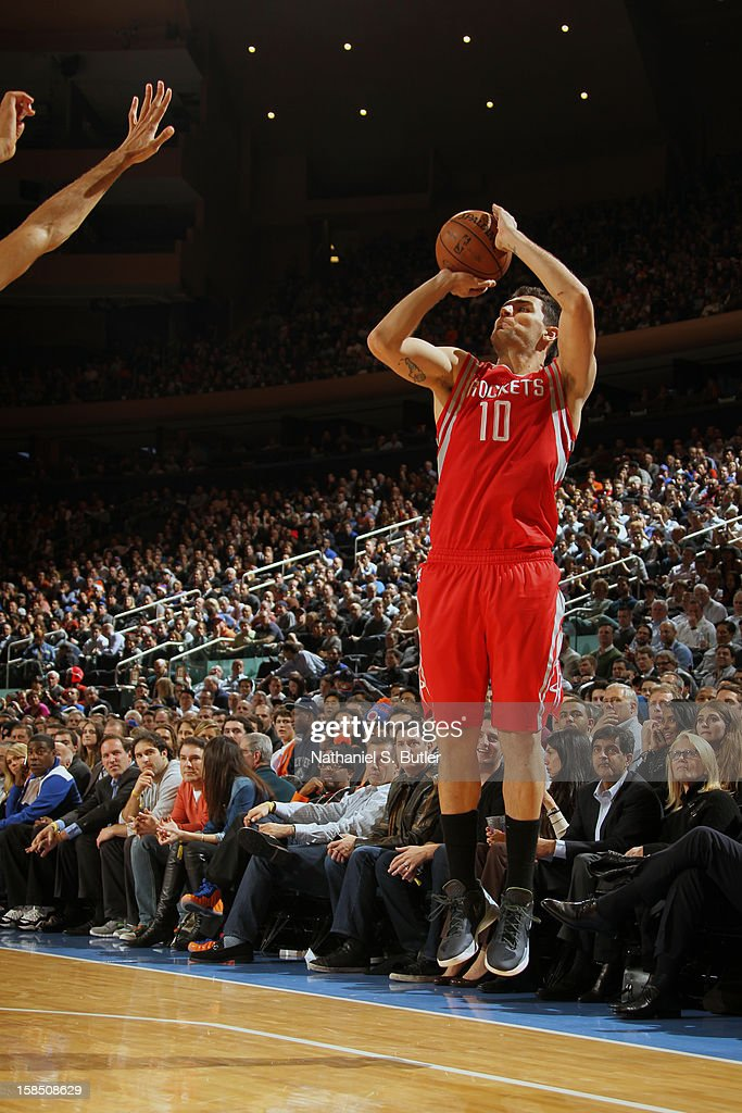 Carlos Delfino #10 of the Houston Rockets takes a three point shot against the New York Knicks on December 17, 2012 at Madison Square Garden in New York City.