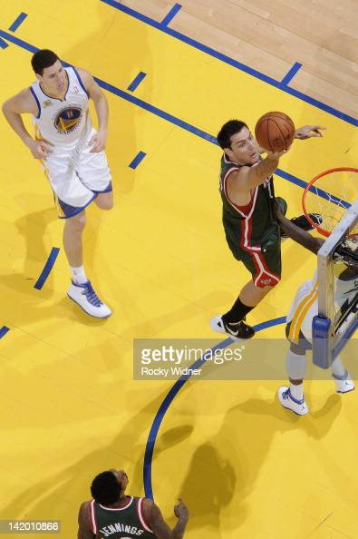 Carlos Delfino of the Milwaukee Bucks drives to the basket for a layup against the Golden State Warriors on March 16 2012 at Oracle Arena in Oakland...