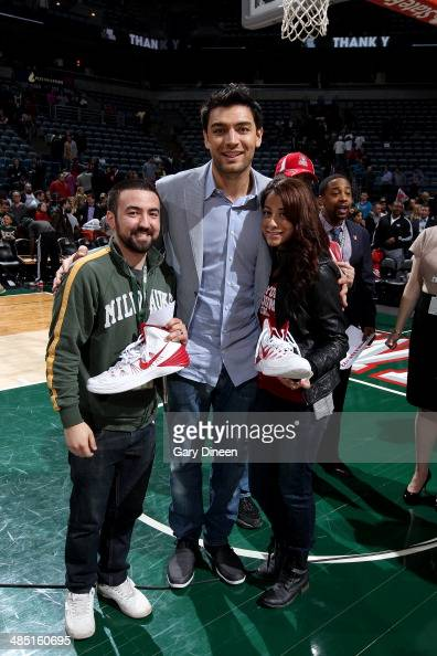 Carlos Delfino of the Milwaukee Bucks gives away his shoes to a fan following the game against the Atlanta Hawks on April 16 2014 at the BMO Harris...