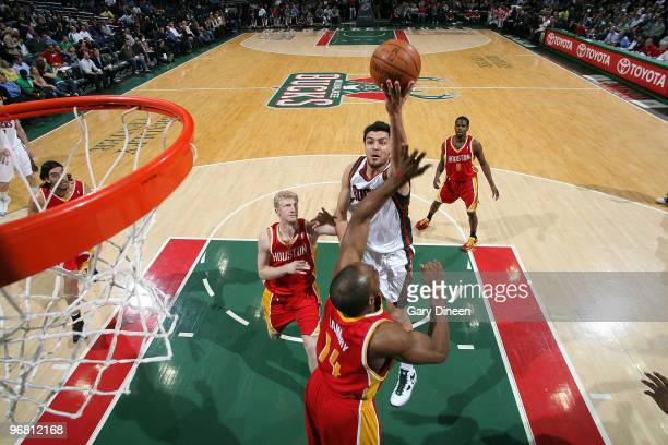 Carlos Delfino of the Milwaukee Bucks shoots a layup against Carl Landry of the Houston Rockets on February 17 2010 at the Bradley Center in...