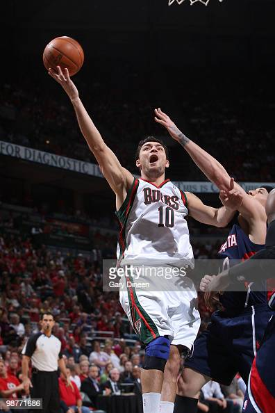 Carlos Delfino of the Milwaukee Bucks shoots a layup against Mike Bibby of the Atlanta Hawks in Game Six of the Eastern Conference Quarterfinals...