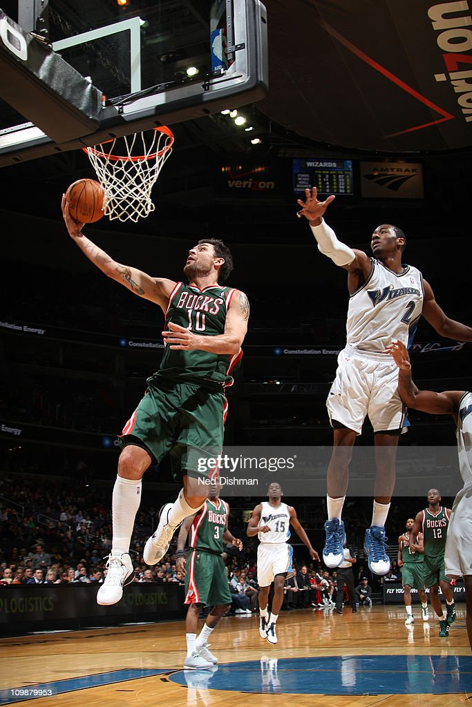 <a gi-track='captionPersonalityLinkClicked' href=/galleries/search?phrase=Carlos+Delfino&family=editorial&specificpeople=206625 ng-click='$event.stopPropagation()'>Carlos Delfino</a> #10 of the Milwaukee Bucks shoots against <a gi-track='captionPersonalityLinkClicked' href=/galleries/search?phrase=John+Wall&family=editorial&specificpeople=2265812 ng-click='$event.stopPropagation()'>John Wall</a> #2 of the Washington Wizards during the game at the Verizon Center on March 8, 2011 in Washington, DC.